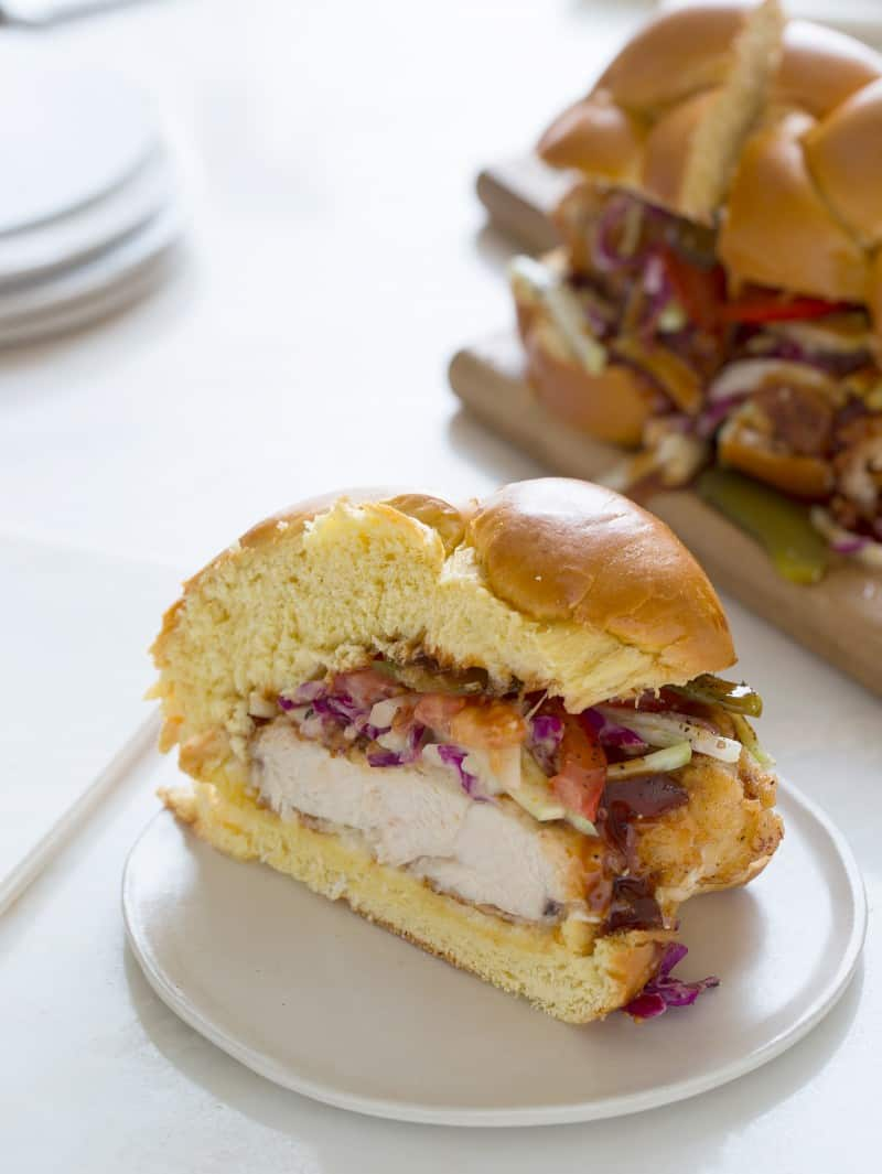 A slice of fried chicken sandwich on a small plate.