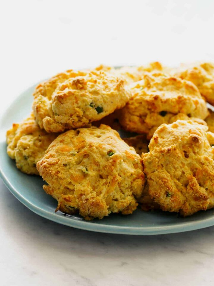 A close up of a plate of cornmeal and jalapeño cheddar biscuits.