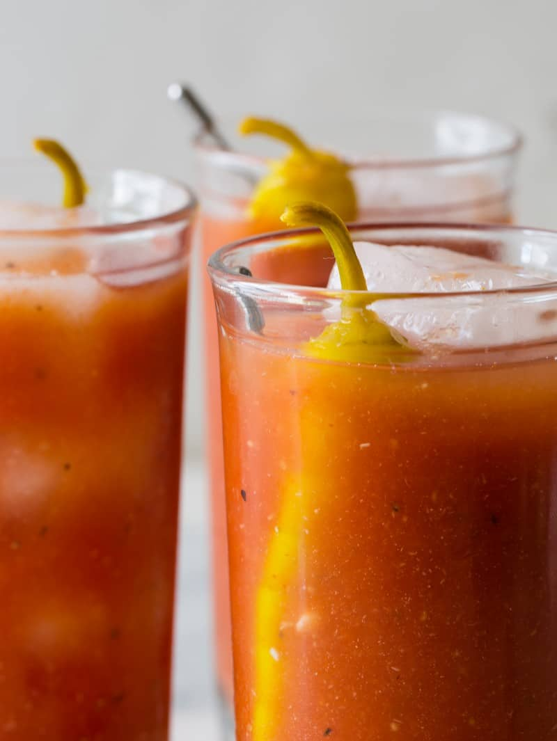 A close up on three bloody marys.