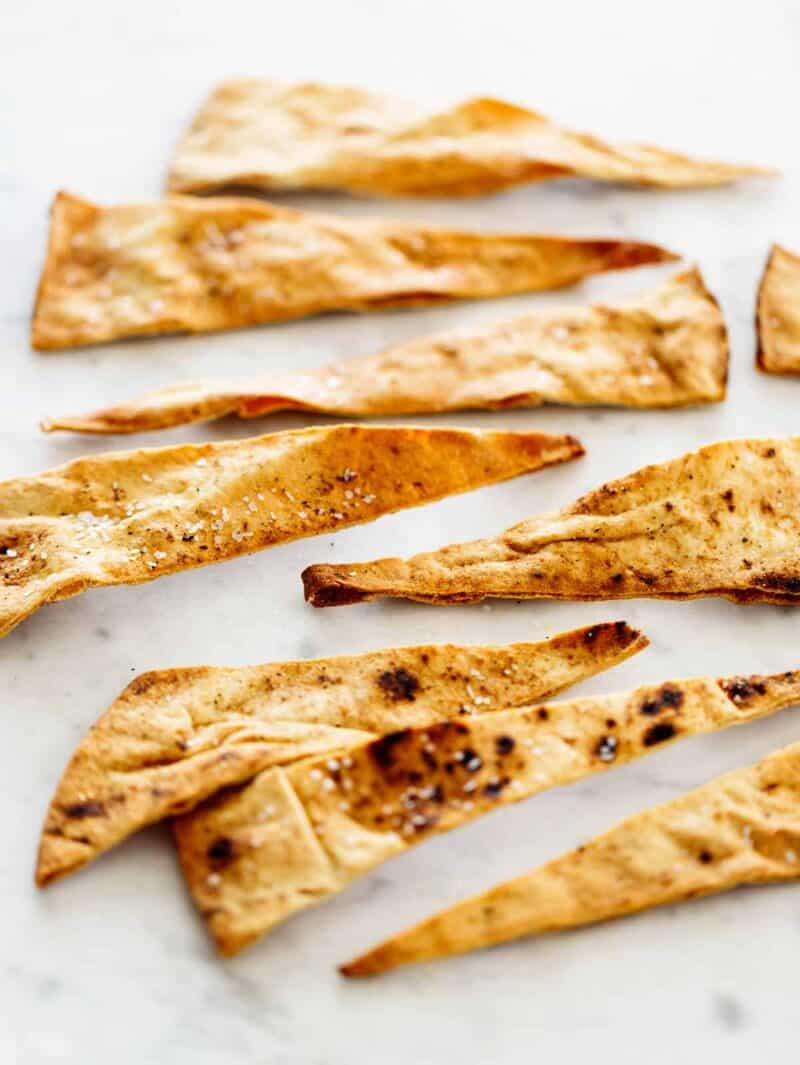 A close up of baked pita chips.
