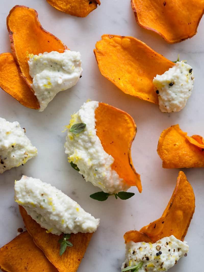 Black pepper and lemon asiago dip recipe on sweet potato chips.