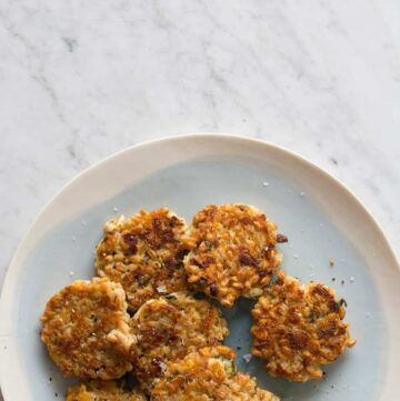 A plate of cheesy apple farro cakes.
