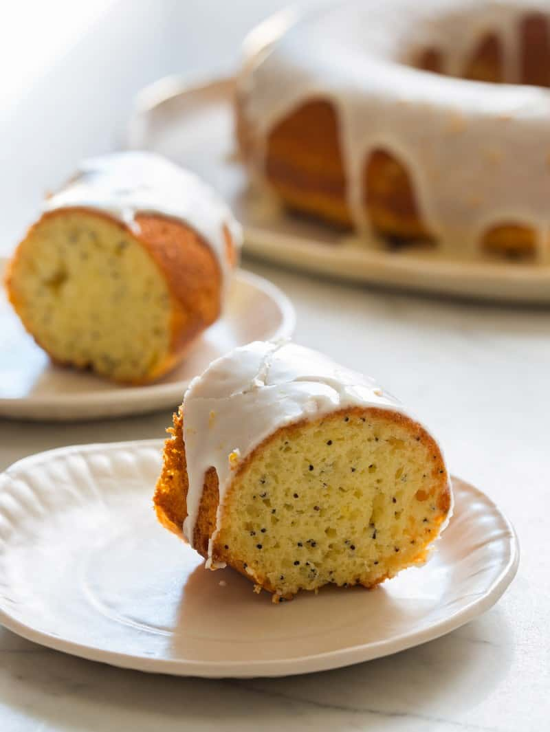 Two slices of Meyer Lemon Pound cake on plates.