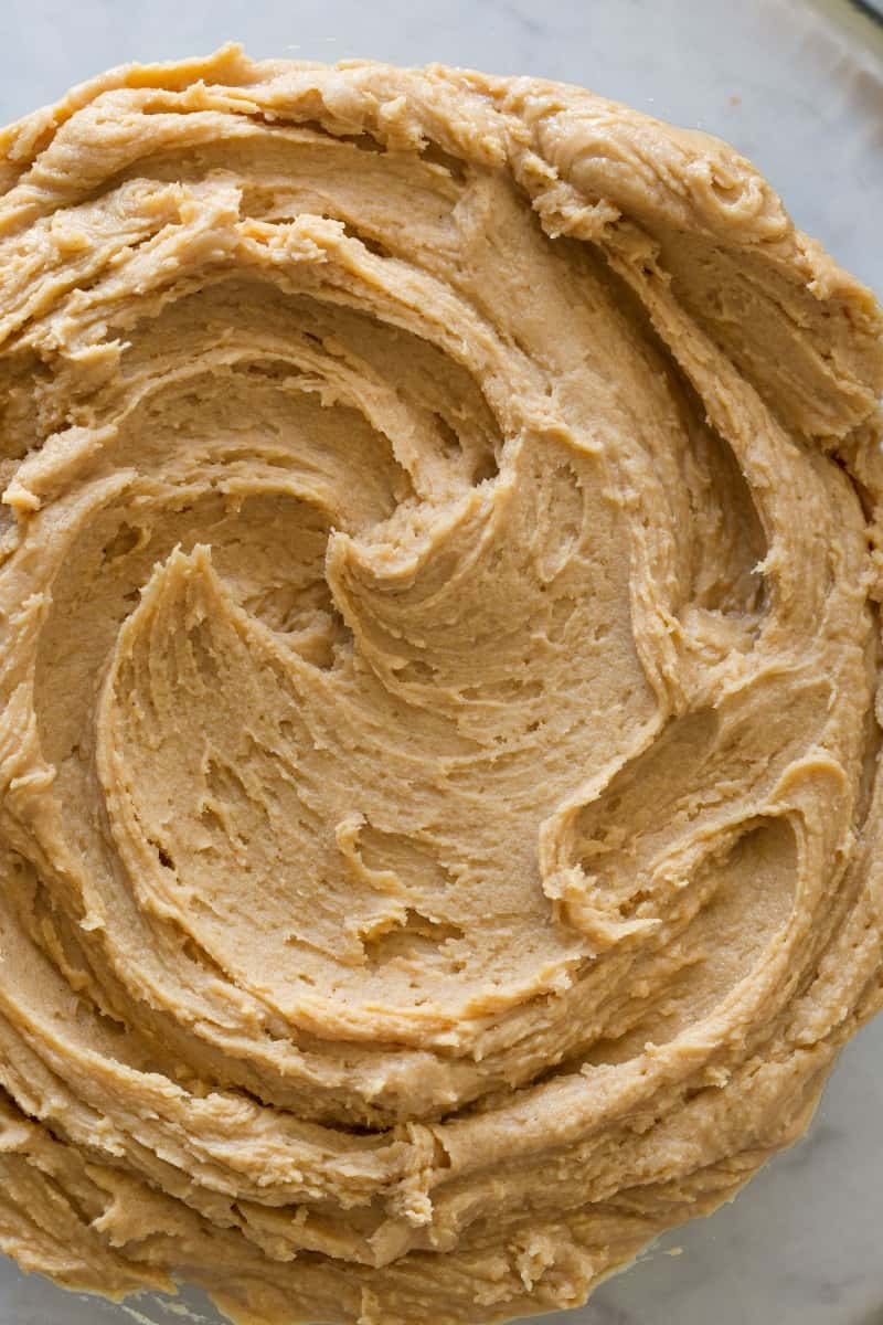 A close up of peanut butter buttercream frosting swirl.
