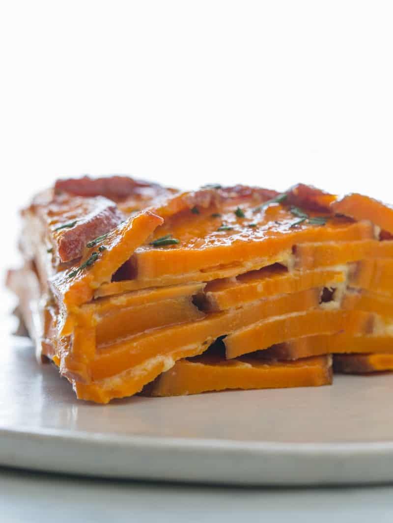 A close up on a slice of a sweet potato gratin.
