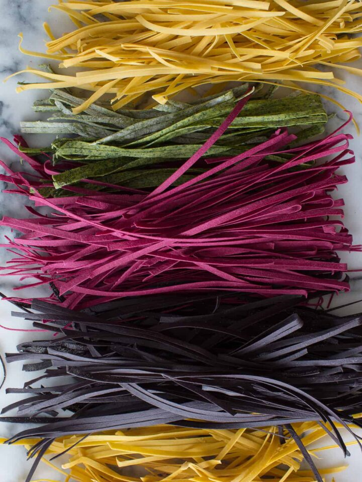 A colorful variety of homemade pastas lined up.