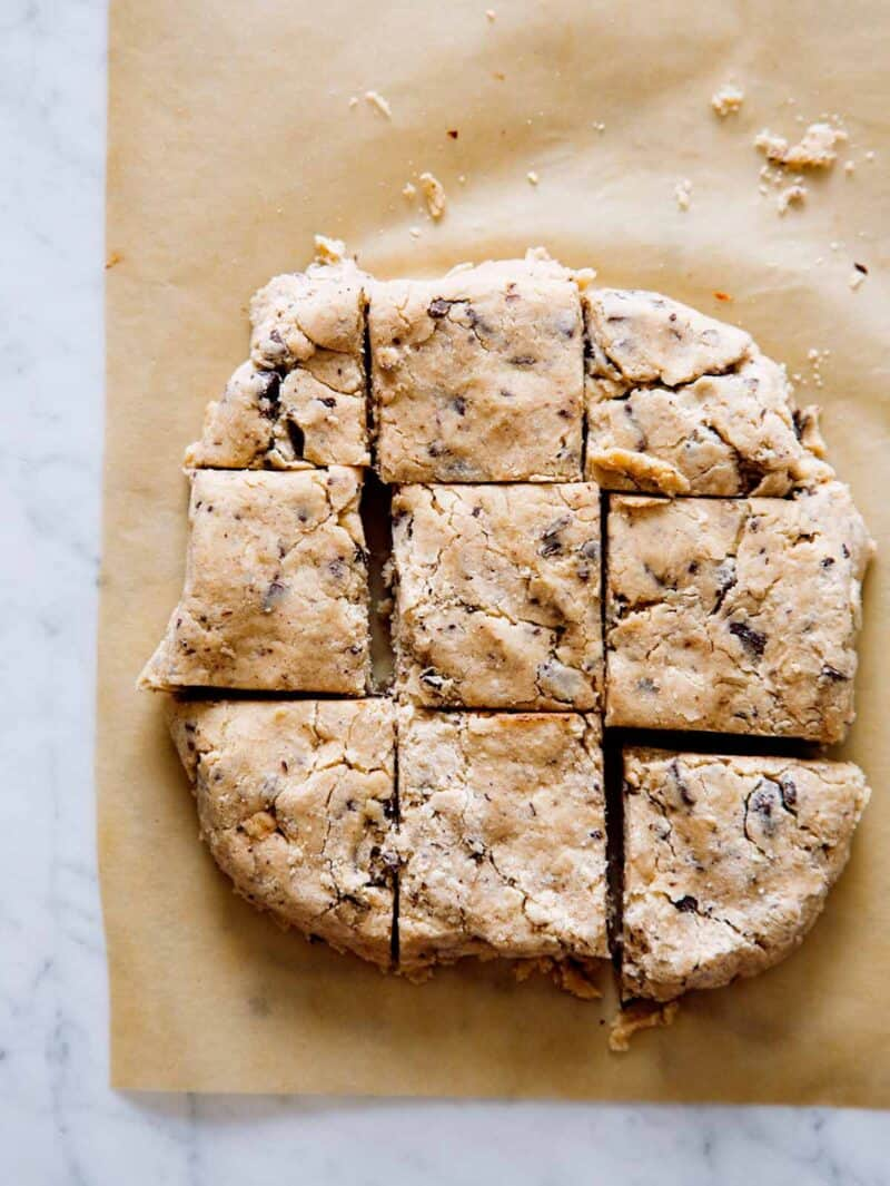 Chocolate chunk and cinnamon scones dough cut into squares before baking.