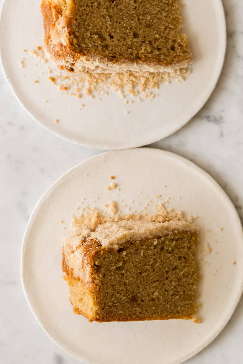 Crumb cake slices on two plates.