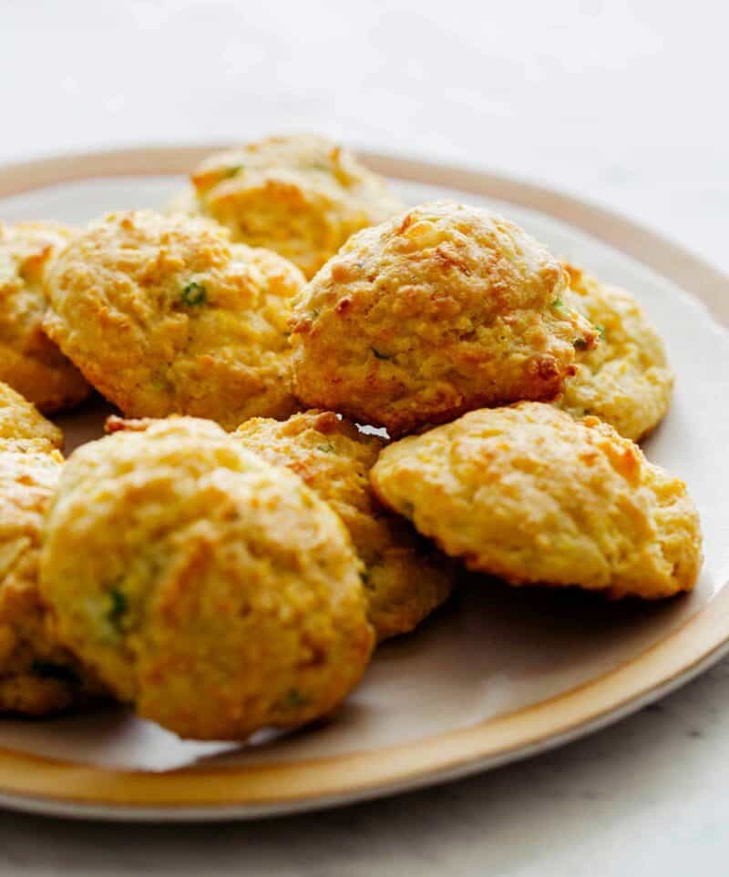 A plate of Cornmeal Drop Biscuits focusing on the cornmeal texture.