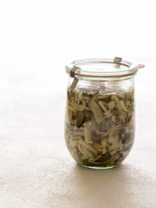 A jar of pickled mushrooms.