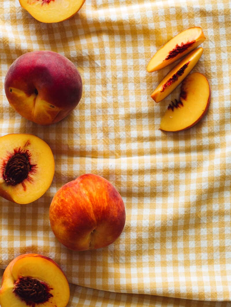 fresh and ripe yellow peaches that are used to make Fresh Peach and Yogurt Drop Biscuits