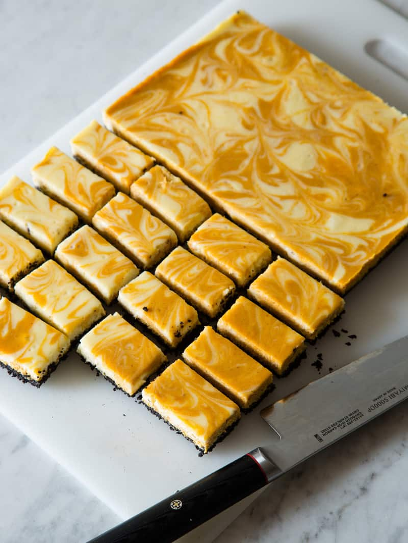 Marbled pumpkin cheesecake bars cup up into bars.