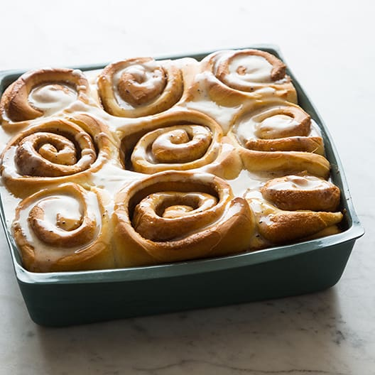 Square pan of baked cinnamon rolls.