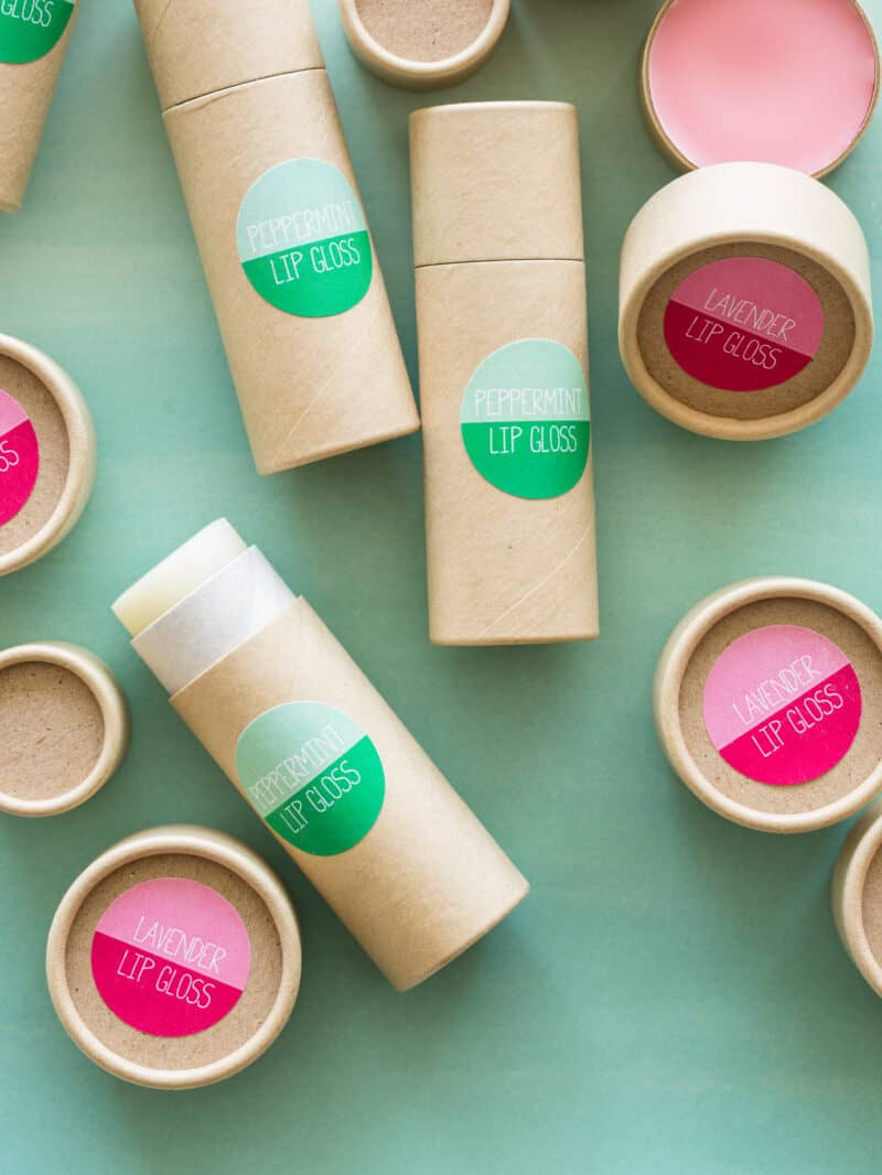 Two different types of DIY lip gloss with green and pink labels.