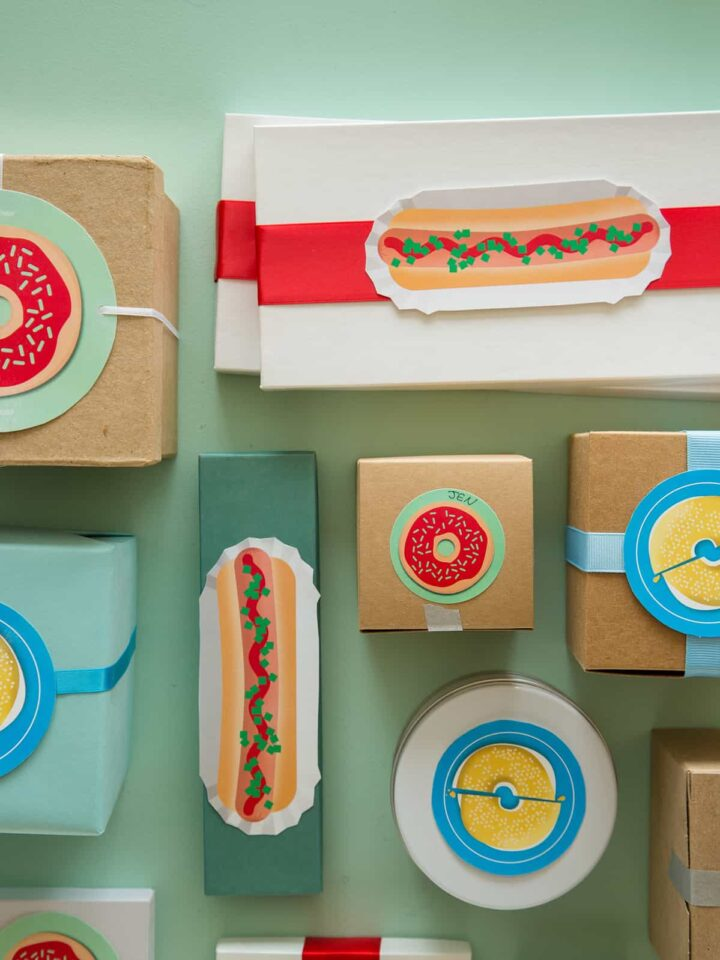 A variety of printable food gift tags on gift boxes.