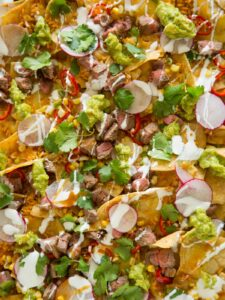 A close up of carne asada nachos.