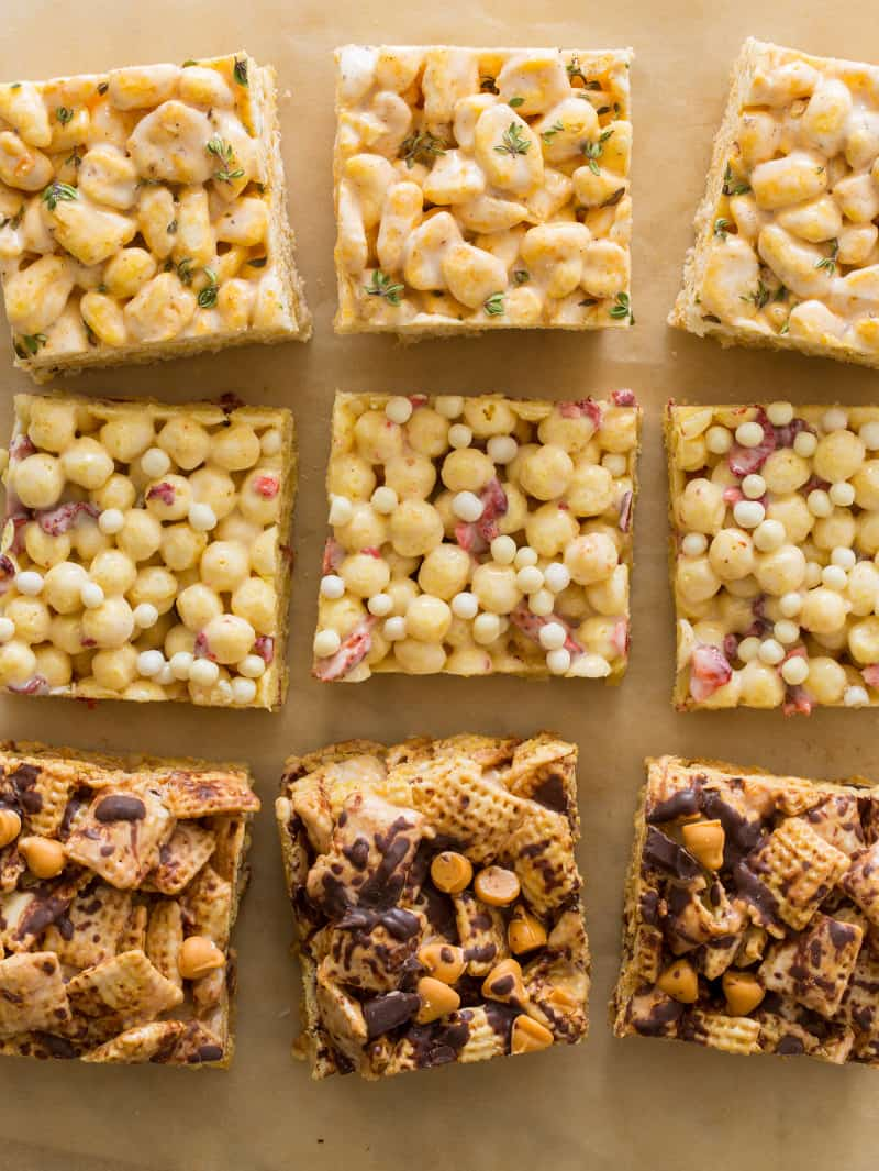 Three different kinds of marshmallow cereal treats on a piece of parchment.