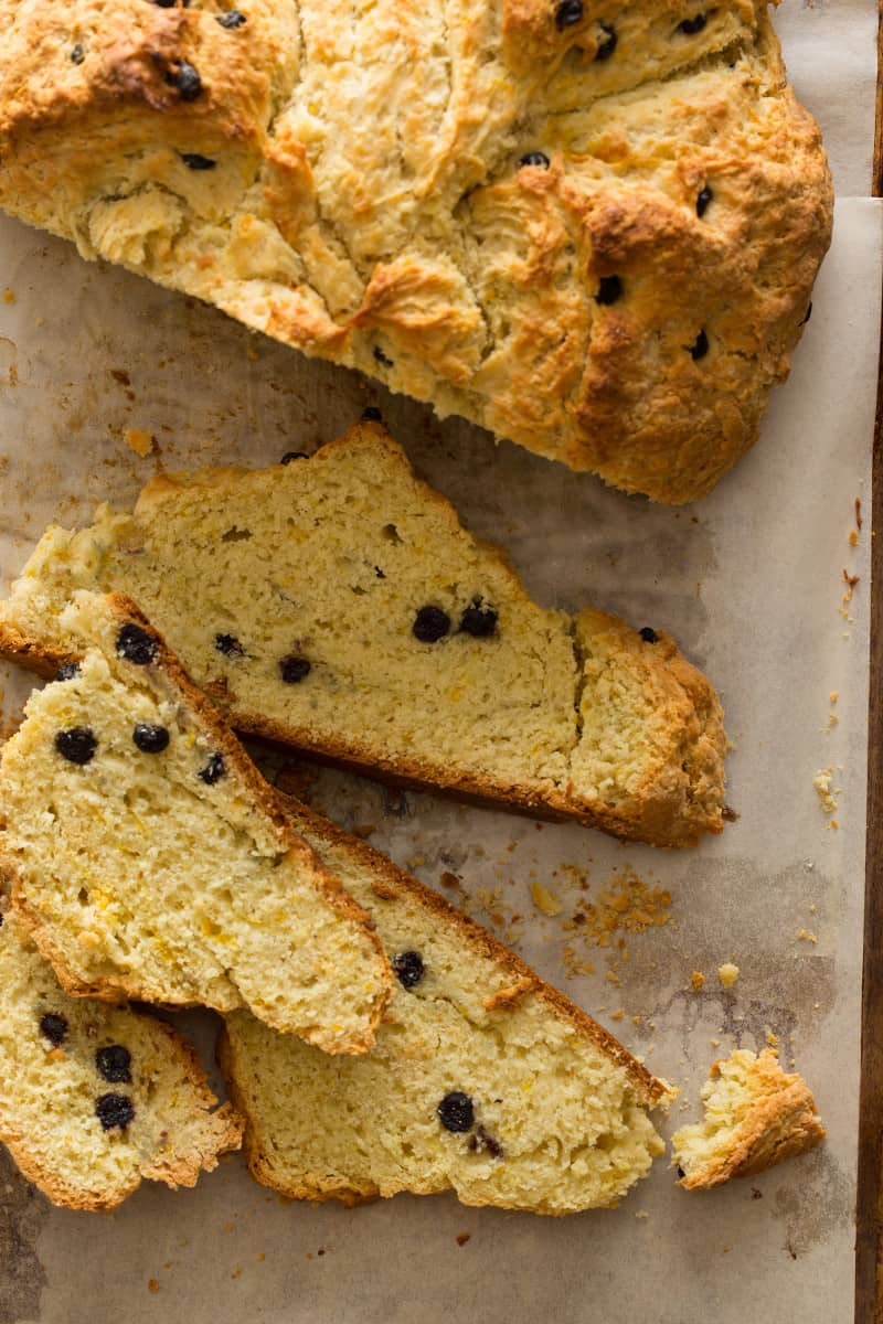A close up of slices of Irish soda bread with dried blueberries.
