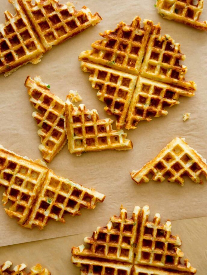 Savory Waffles shot overhead with some broken in half.
