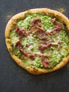 A whole English pea, prosciutto, and burrata pizza.