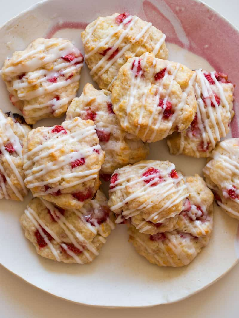 Strawberry Shortcake cookies on a platter stacked.