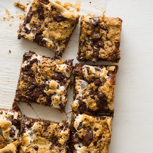 Oatmeal s'mores bars on a surface cut into squares.