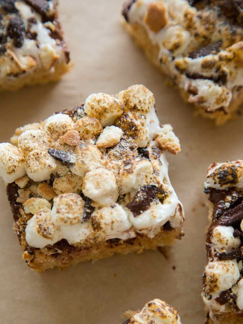 Close up on a slice of S'mores Rice Krispies treats on a piece of parchment.