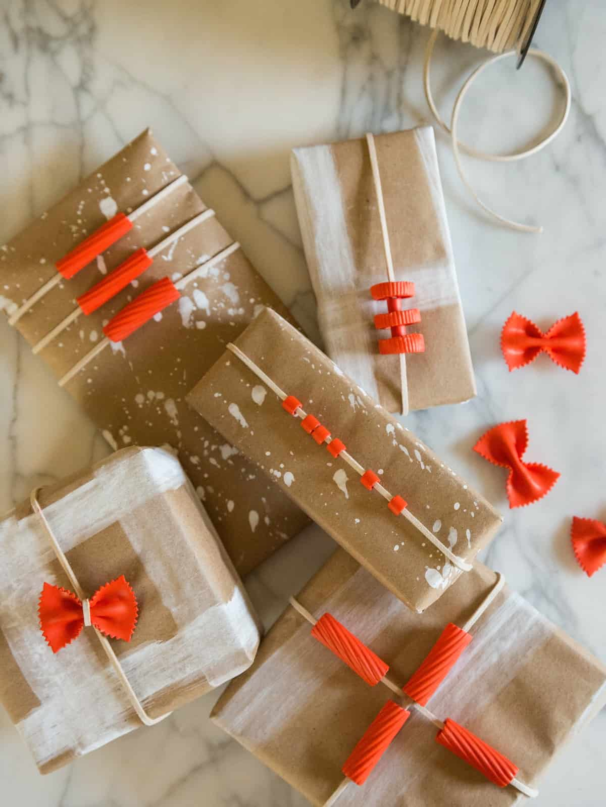 A variety of boxes wrapped in DIY pasta gift wrap.