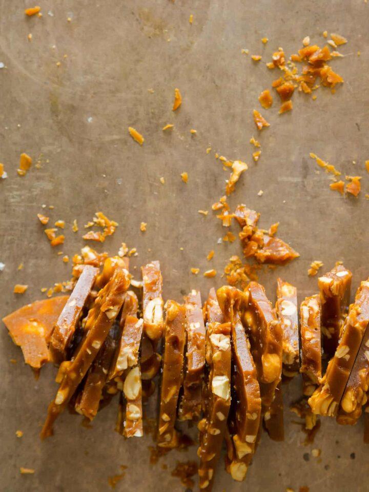 Salted cashew brittle, broken up into strips.