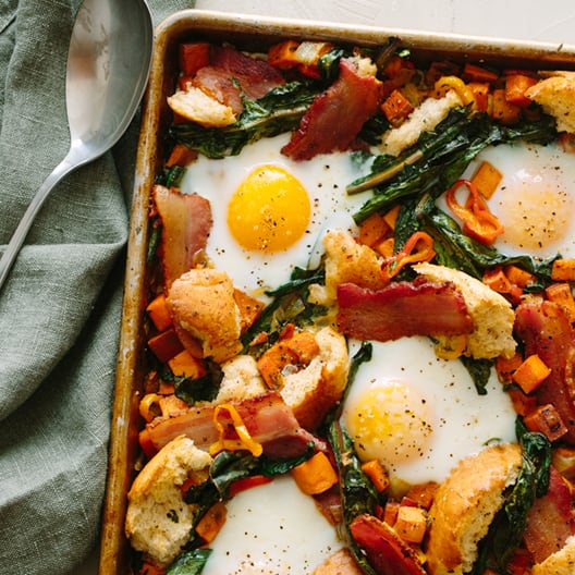 Breakfast pan in a sheet pan with a napkin and a spoon.