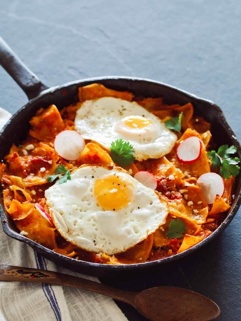 chilaquiles roja recipe, with fried eggs on top.