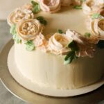A close up of a whole floral wreath cake.