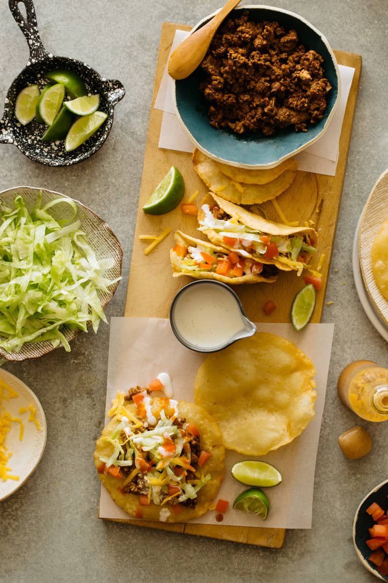 DIY hard and puffy corn tortillas, flat and folded, tacos and fixings.