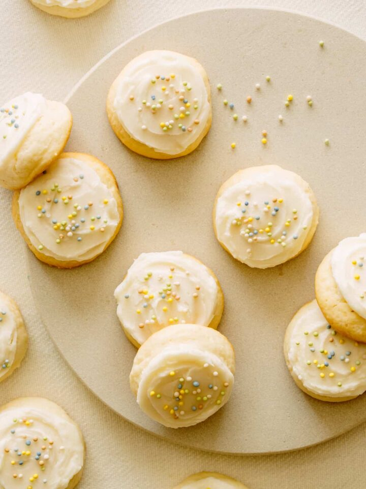 Soft and fluffy sugar cookies with vanilla frosting and sprinkles.