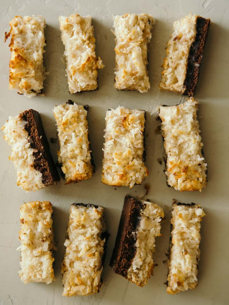 Coconut and peanut butter brownie bars sliced and lined up.