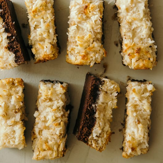 Coconut and peanut butter brownie bars cut into rectangles.
