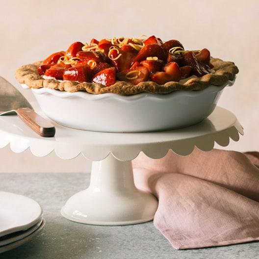 Strawberry Cream Pie in a baking dish on a cake pedestal.