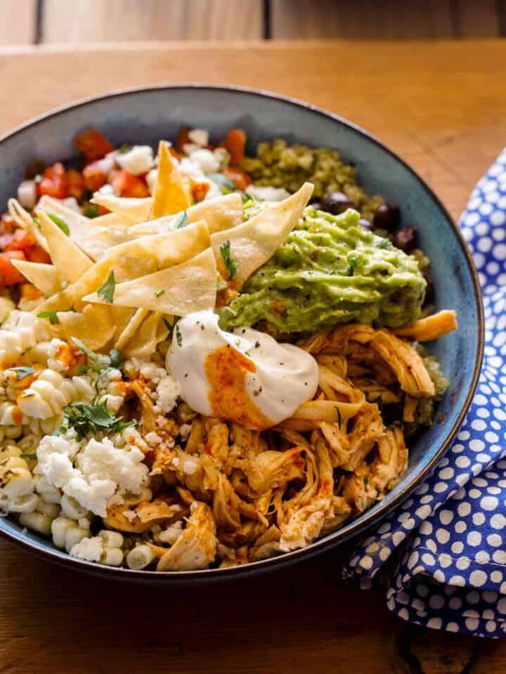 A close up of a honey chipotle chicken burrito bowl,  a delicious dinner recipe.