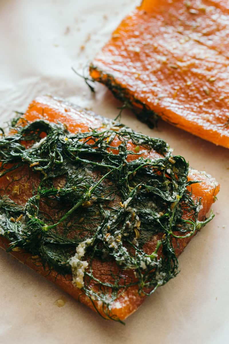 A close up of salmon with dill and dill on top.