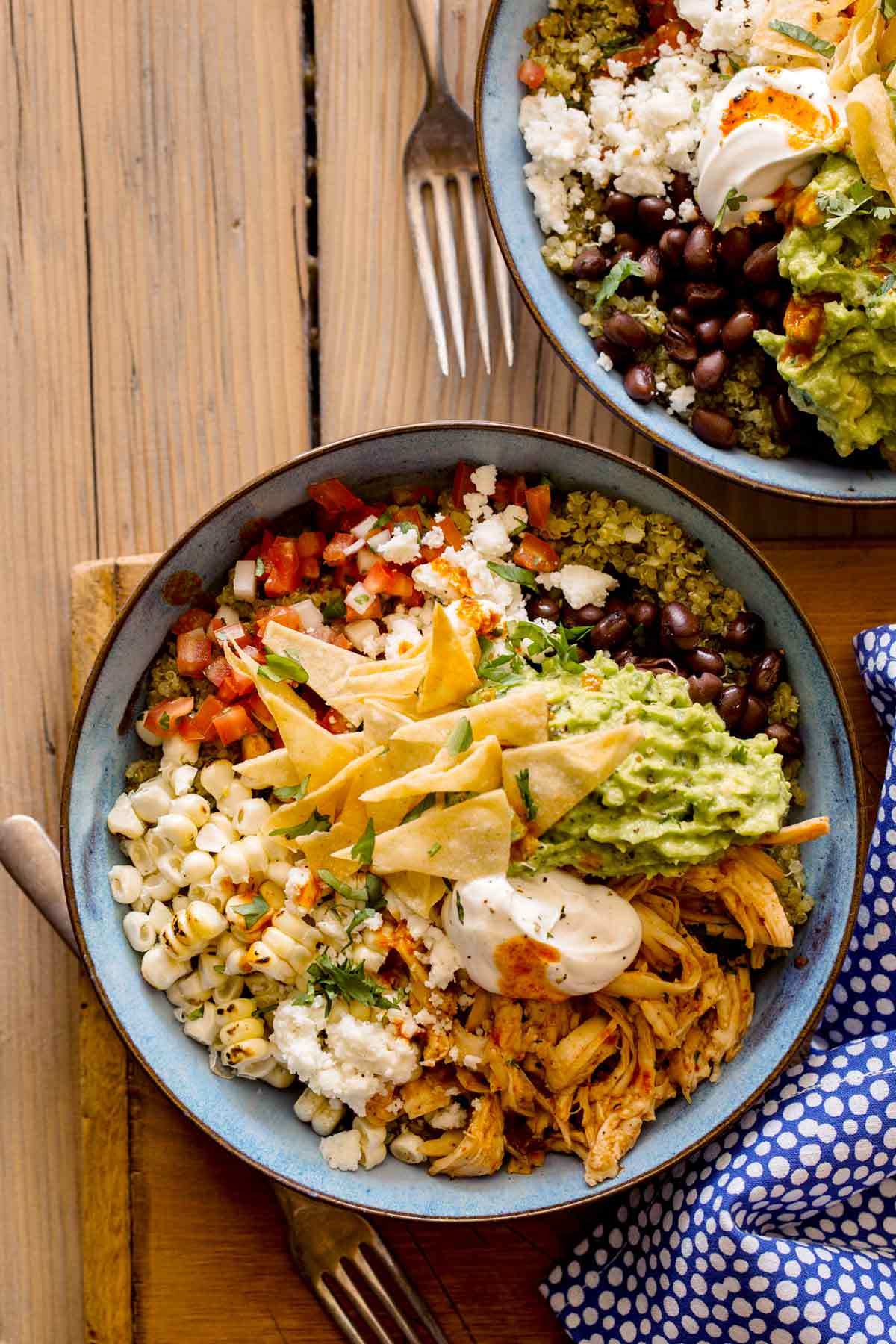 Honey chipotle chicken burrito bowls with forks.