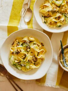 Bowls of sweet corn pesto with pappardelle and zucchini noodles.