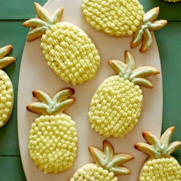 Pineapple shaped lime sugar cookies with pineapple buttercream.