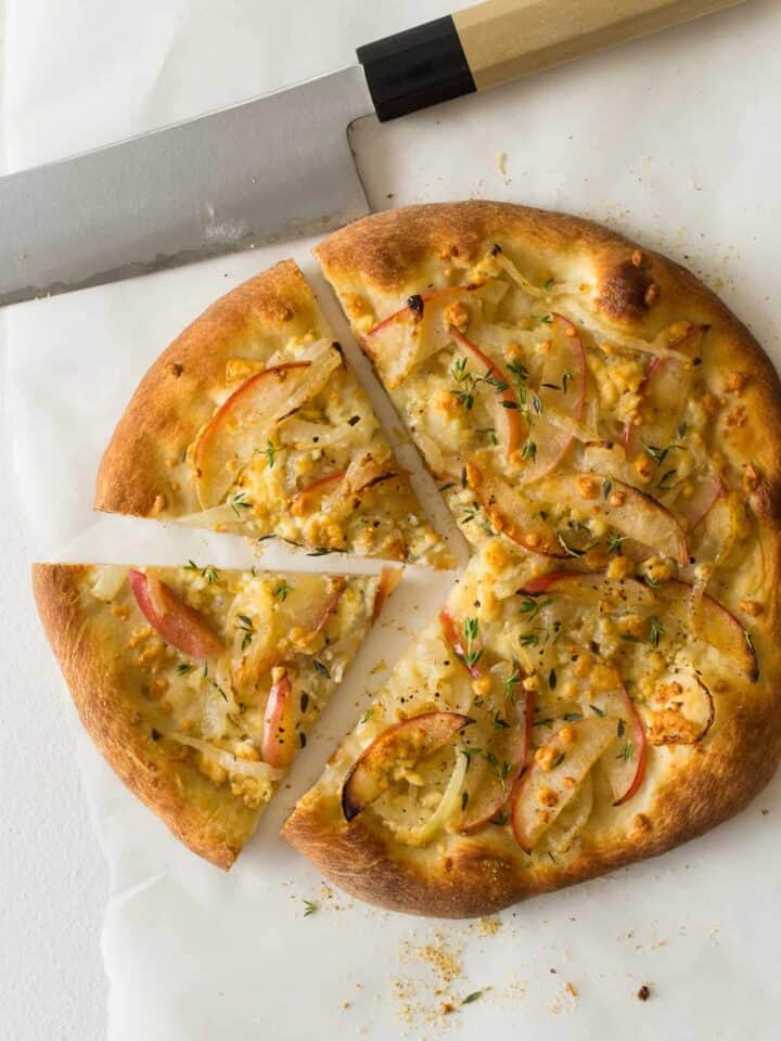A sliced caramelized onion, apple, and bleu cheese pizza.