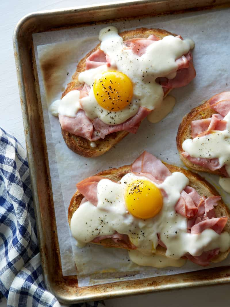 Croque Madame Toast on a baking sheet with parchment.