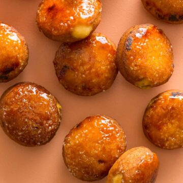 Artfully scattered pumpkin crème brûlée doughnuts.