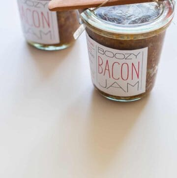Jars of bacon jam with printed labels attached.