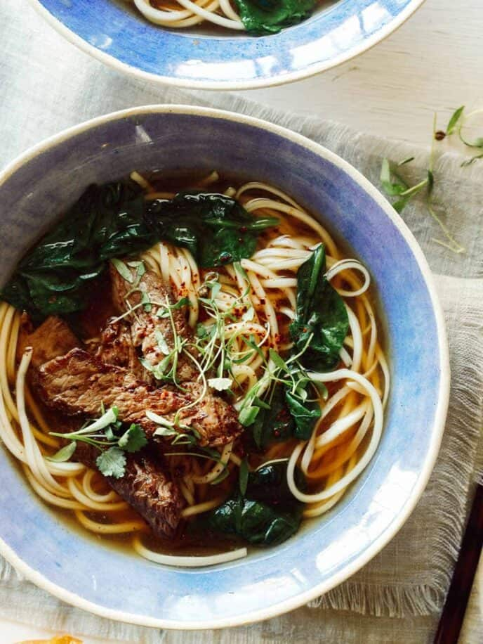 Beef noodle soup recipe in two bowls.