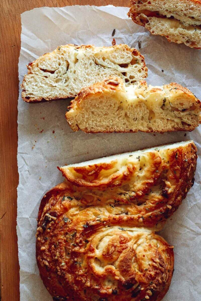 Sliced cheesy roasted garlic and herb pane bianco.