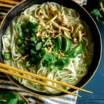 Green curry noodle soup in a bowl.