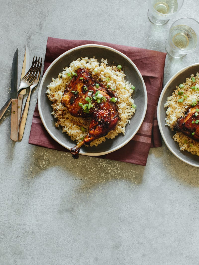garlic and ginger braised chicken recipe over rice with green onions and sesame seeds.